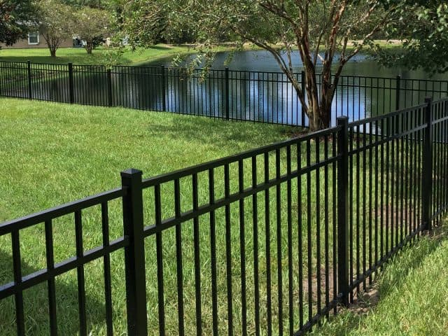 https://www.superiorfenceandrail.com/wp-content/uploads/2021/02/Youngsville-Fence-Installation-black-aluminum-lake-in-background-640x480.jpg