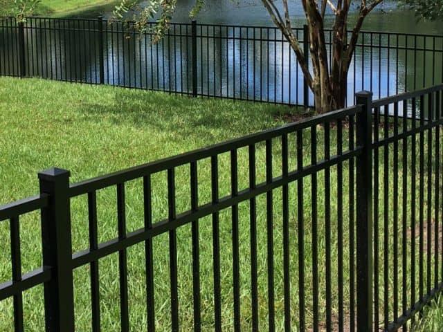 https://www.superiorfenceandrail.com/wp-content/uploads/2021/06/Fence-Installation-black-aluminum-lake-in-background-640x480.jpg